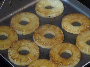 Jess cooks pineapple.