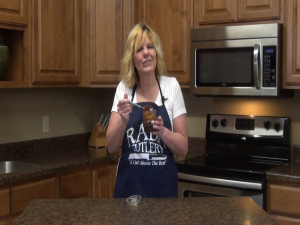 Kristi poses with a jar of homemade caramel.