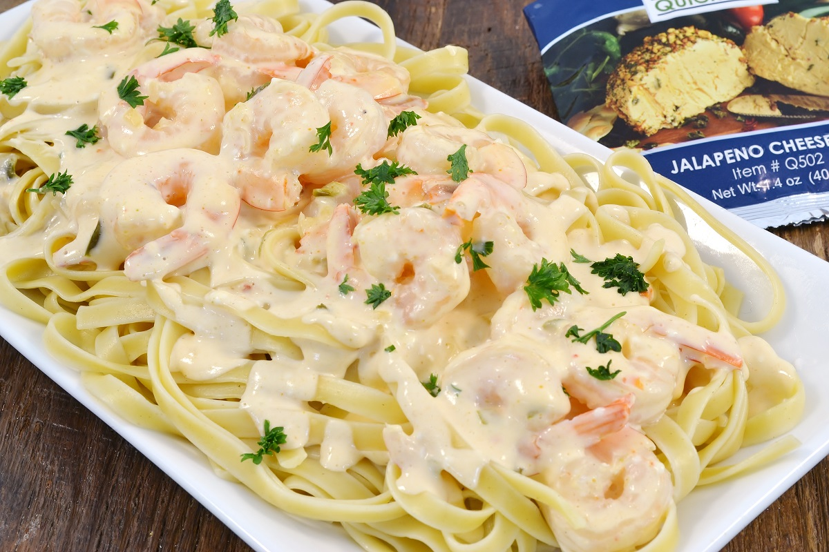 Shrimp with jalapeno sauce and pasta.