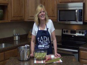 Kristi poses with stewed rhubarb ingredients.