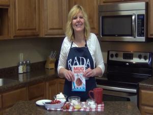 Kristi poses with Rada's Mug Shots cookbook.