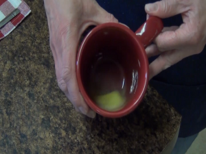 Butter is melted in a mug.