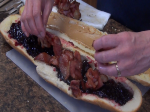 Kristi adds bacon to jelly.