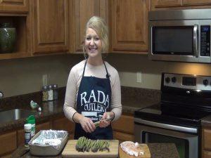 Jess prepares to make bacon-wrapped asparagus.