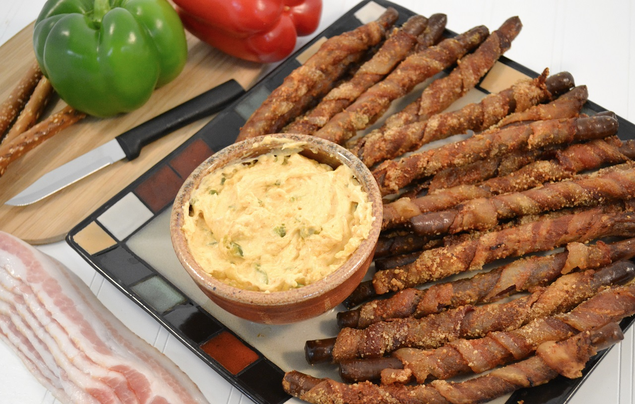 A delicious platter of bacon-wrapped pretzel rods with jalapeno dip and a Rada Peeling Paring knife.