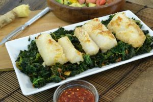 A plate of baked cod with a Rada Vegetable Peeler.