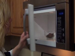 Kristi melts chocolate in microwave.