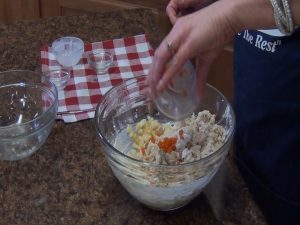 Kristi prepares chicken mixture.