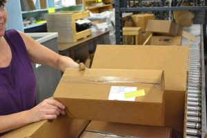A Rada employee sorts orders.