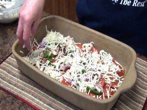 Kristi adds ingredients to Rada Rectangular Baker.