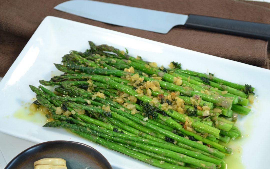 A plate of Roasted Asparagus with a Rada knife.