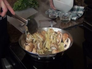 Kristi cooks onions.