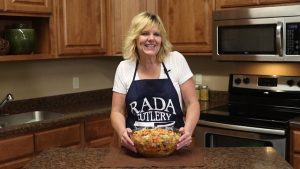 Kristi poses with completed taco salad.
