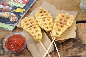 Waffle-style corn dogs with sauce and cookbook.