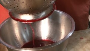 Cherry juice is drained.