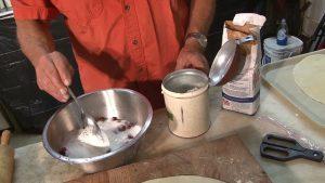 Dan adds cornstarch to mixture.