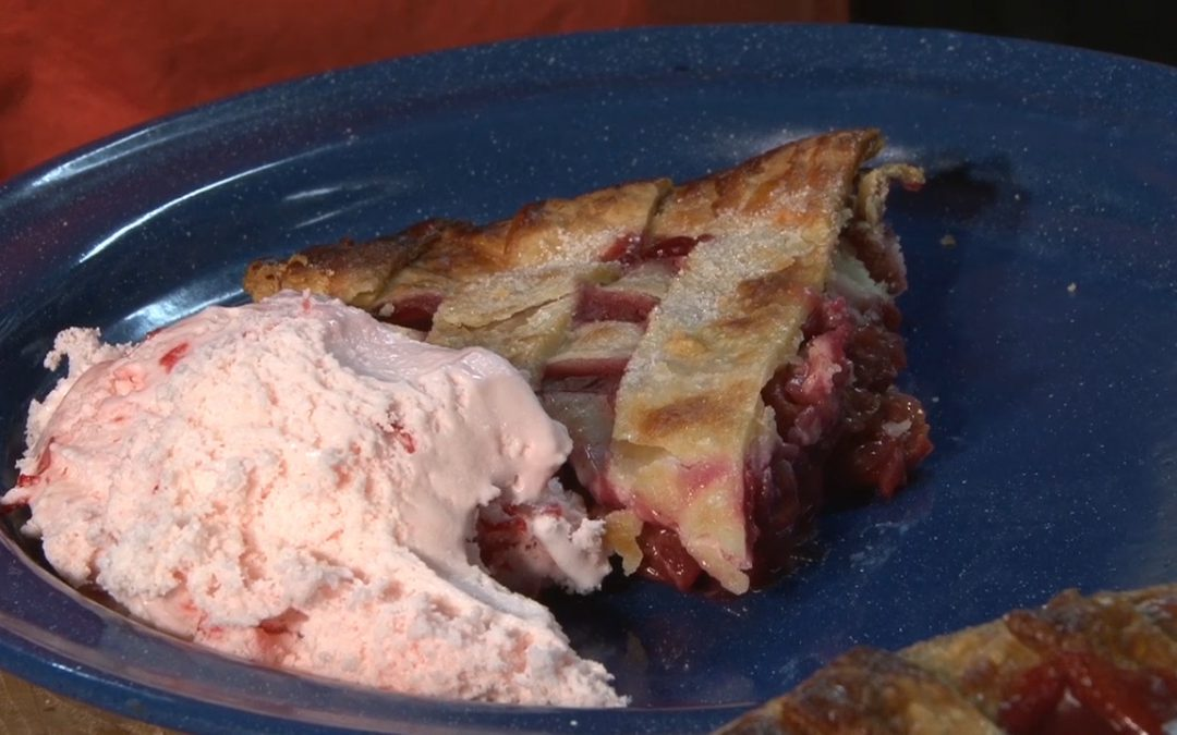 A delicious homemade smoked cherry pie with cherry ice cream.