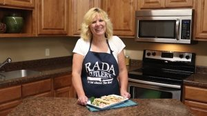 Kristi poses with completed fish tacos with sriracha slaw.
