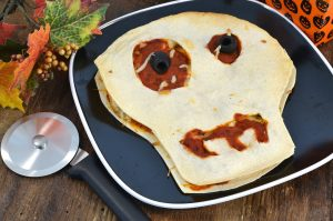 A delicious screaming skull chicken parm quesadilla with a Rada Pizza Cutter.