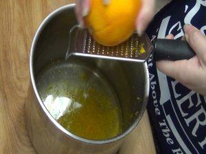 Jess zests an orange.