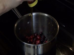 Jess adds honey to cranberries.