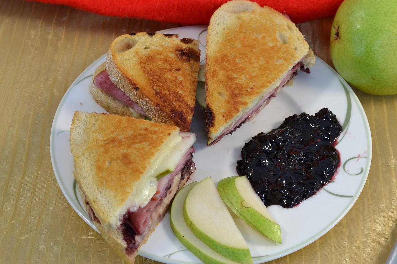 A delicious ham and sourdough sandwich with Merlot sauce.