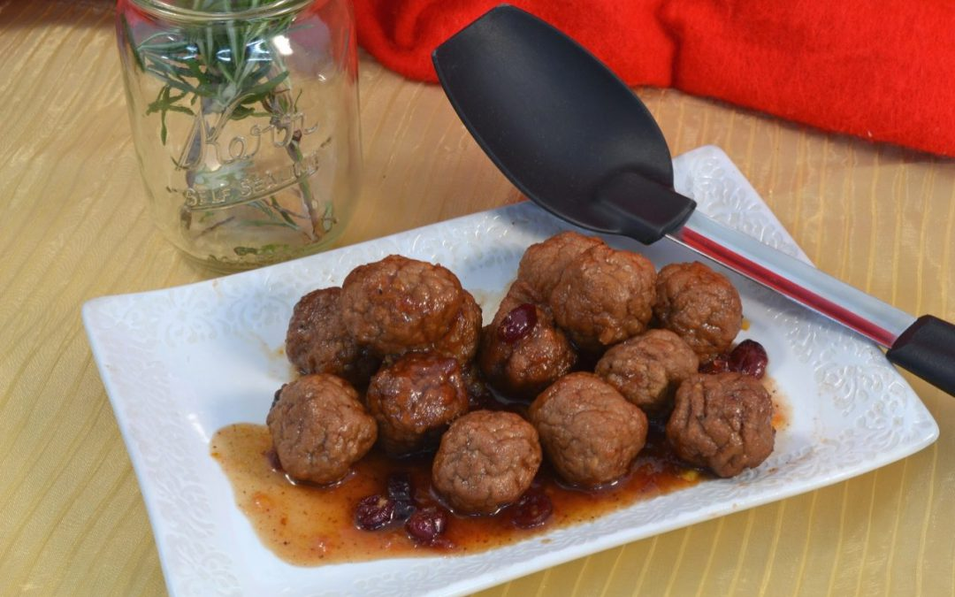 A plate of turkey cranberry meatballs with a Rada Non-Scratch Spoon.