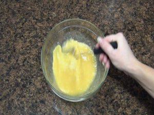 A mixture is stirred with a Rada Handi-Stir.