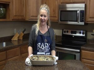 Jess poses with a completed chicken mushroom bake in a Rada Rectangular Baker.