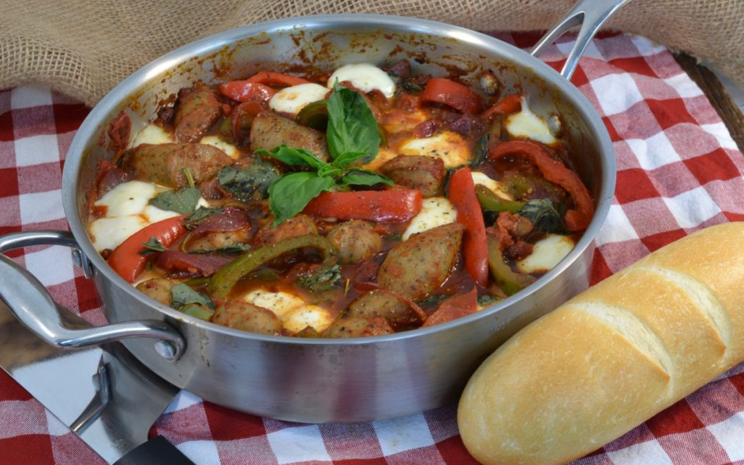 A delicious pan with Italian sausage, vegetables, and French bread.