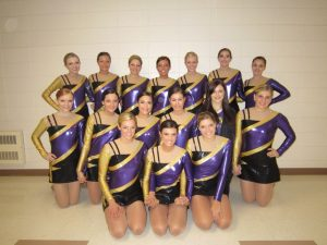 A school dance team poses for a photograph.