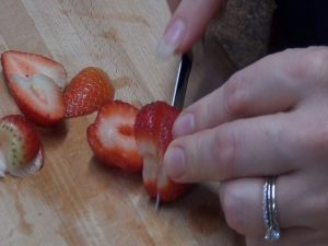 Jess slices strawberries with Rada's best-selling Regular Paring knife.