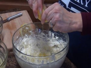 Jess adds lemon to mixture.