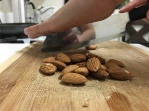 Kristin chops almonds with a Rada knife.