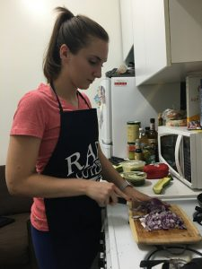 Kristin chops onions with a Rada Cook's Utility knife.