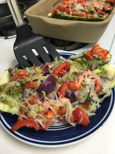 A Rada Non-Scratch Spatula serves a vegetable dish from a Rada Rectangular Baker.