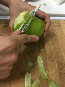 Kristin peels an apple with the Rada Vegetable Peeler. It's great for peeling fruit, too!