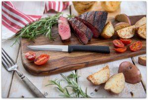 A juicy steak with a Rada Stubby Butcher knife.