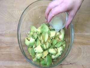 Lime juice is added to a bowl.