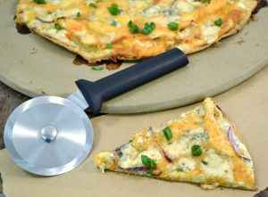 A delicious buffalo chicken pizza cut with a Rada Pizza Cutter.