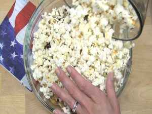 Ingredients are added to popcorn.