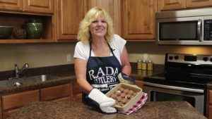 Kristi poses with completed meatballs.