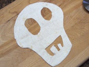 A tortilla cut to resemble a skull.