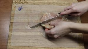 Chicken is halved with a Rada knife.