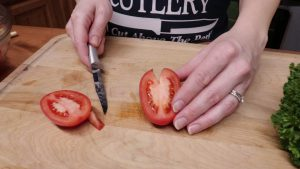 Jess uses a Rada paring knife to slive tomatoes.