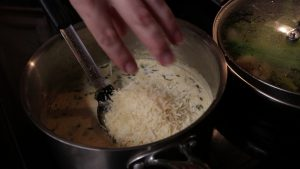 Jess adds Asiago cheese.