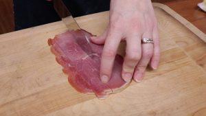 Jess cuts prosciutto with a Rada French Chef.